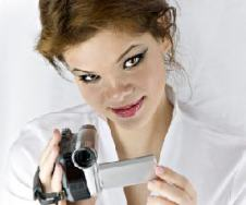 pretty woman holding video camera