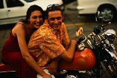 happy couple on motorcycle