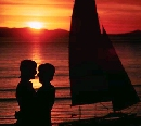loving couple embracing with sunset