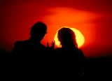 romantic lovers in sunset