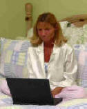 woman working from home with laptop in her pajamas