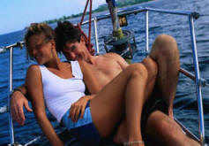 lovers on a sailboat on the high seas