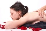 sensuous happy ending massage with rose petals